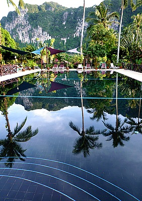 Mirroring of the limestone mountains of Ao Nang in the swimming pool of the Lai Thai Resort